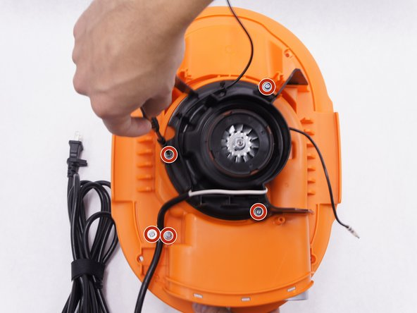 Remove the five 15mm screws from the plastic motor cover and power cord clamp using a PH2 screwdriver.