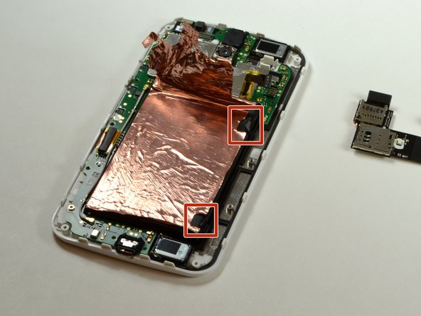 Image 1/3: Remove the battery by pulling the right side of it upwards.