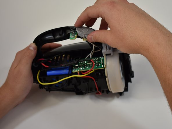 The power button can be removed by gently lifting it off the circuitry.