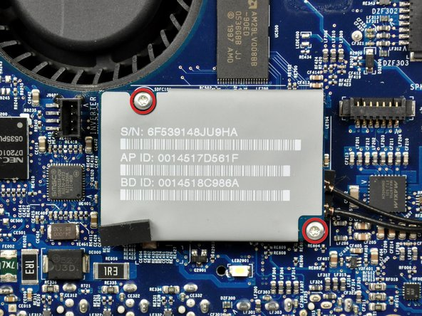 Image 1/2: Lift the AirPort/Bluetooth board up from its left edge to separate it from its socket on the logic board.