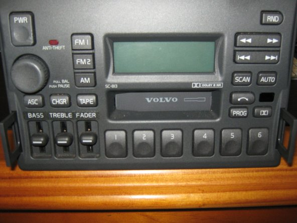 Image 2/3: Insert your fingers into the holes on both sides of the radio, and gently slide out.  You will NOT need to disconnect the power, and antenna connections
