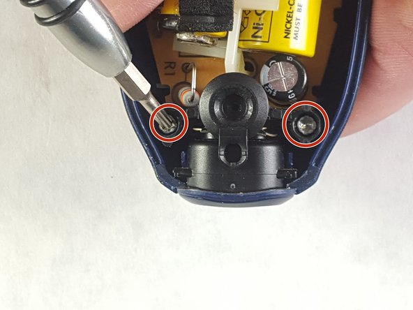 Remove the two T8 2mm Philips screws holding onto the bracket over the charge port.