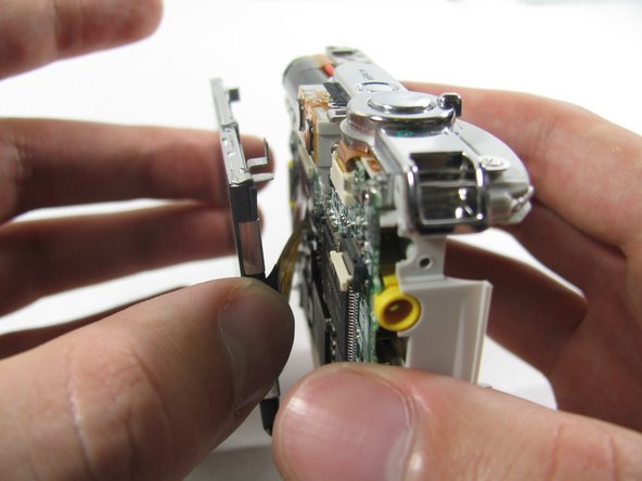 Image 1/3: Remove the ribbon cord from its connector.
