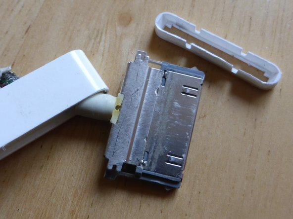 An Apple cable has a much more robust 30-pin connector than cheaper non-Apple cables. The Apple connector has 2 plates soldered to the back of it - one on the top and another on the bottom. Cheaper connectors do not have these shielding plates.